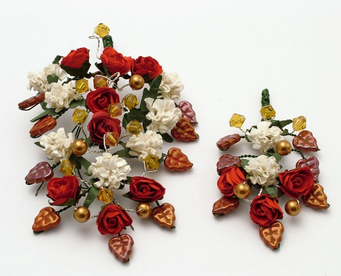 Men's medieval style wedding corsage and buttonhole with red roses and bronze pearls