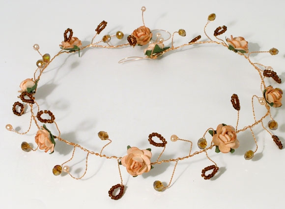 Medieval wedding style peach coloured rose hair vine with bronze colour scheme