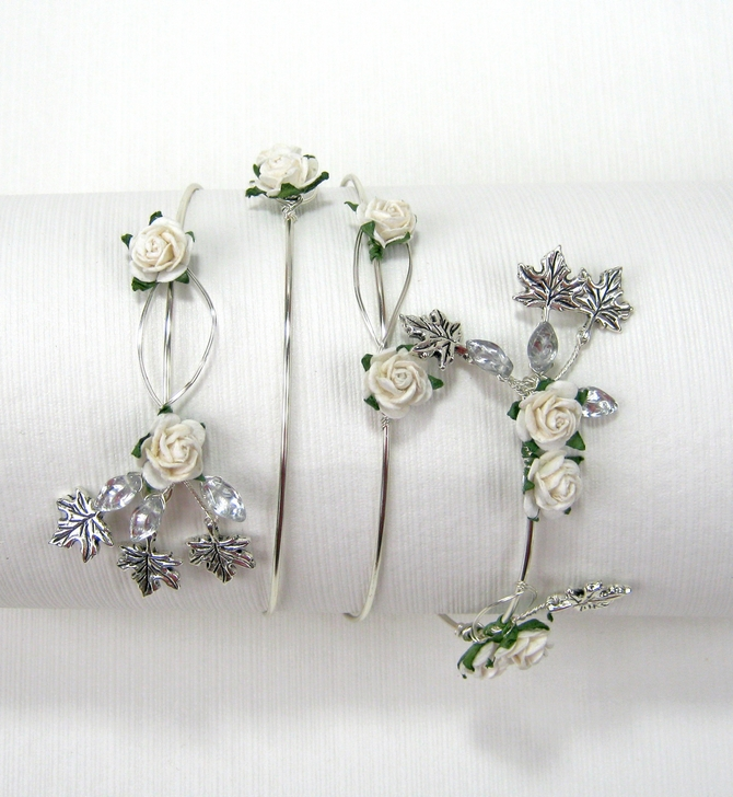 Upper arm cuff with ivory roses, silver leaves on silver wire.