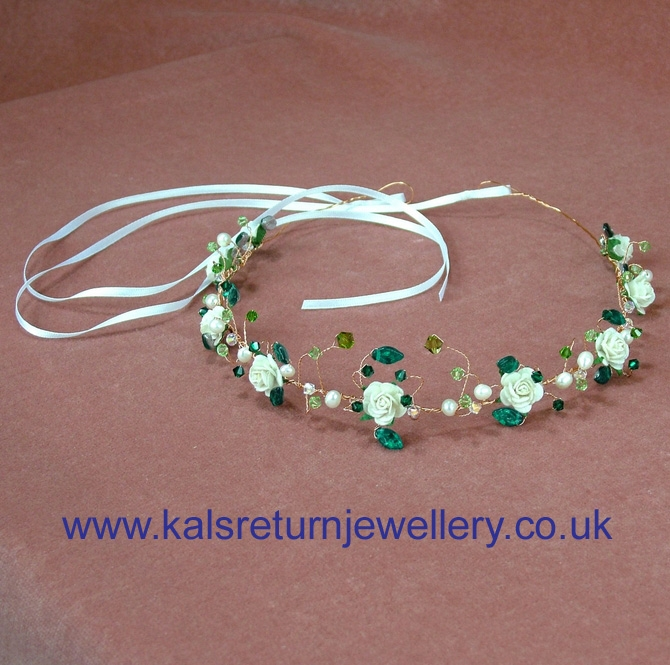 Gold bridal tiara with ivory roses and emerald green crystals