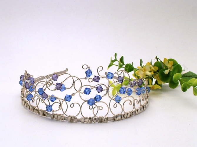 Contemporary style silver wedding tiara with blue and tanzanite Swarovski crystals.
