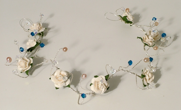 Bridesmaid's or prom hair vine with ivory roses, fresh water pearls plus capri blue and sparkly ab Swarovski crystals.