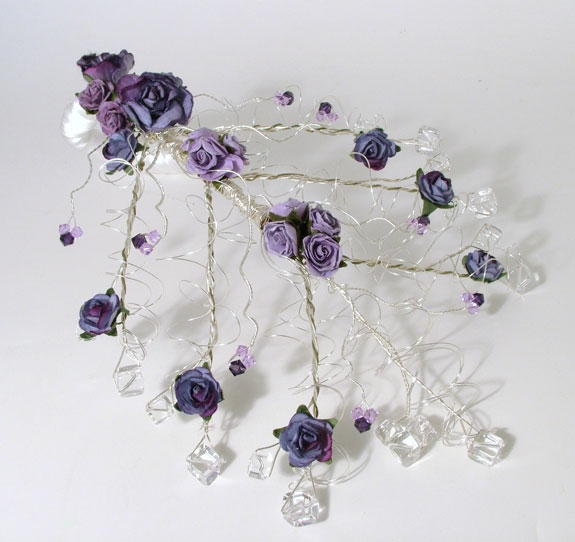 Bride's cascading Rock Crystal wedding bouquet with purple and lilac roses