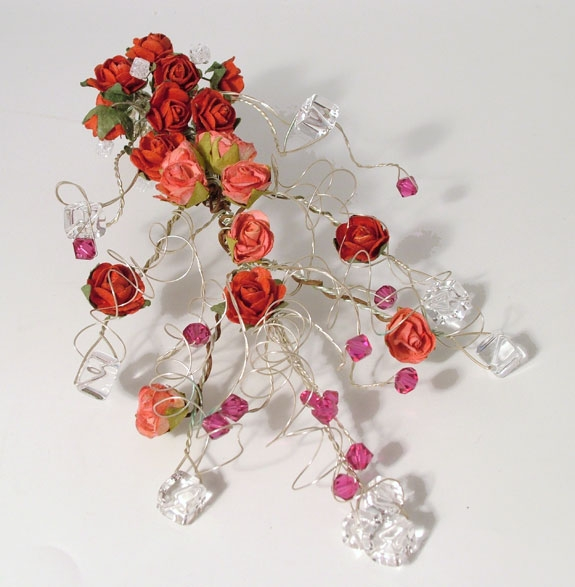 Bridesmaid's cascading Crystal Bouquet with red rosesand cerise Swarovski crystals.