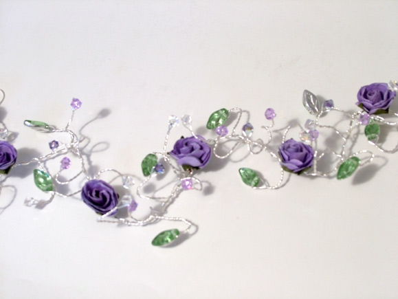 Rustic or woodland wedding hair vine with lilac and purple roses, silver and green leaves plus tanzanite and lilac Swarovski crystals