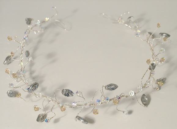 Wedding or prom hair vine on silver wire with silver leaves with peach and sparkly colouredSwarovski crystals