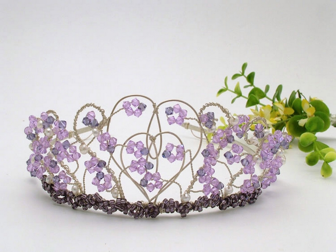 Silver heart shaped design bridal tiara with lilac and purple Swarovski crystals.