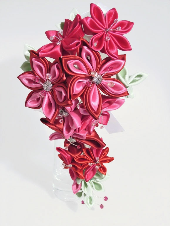 Bride's cascading Kanzashi flower wedding bouquet in pink, red and pale green colour scheme