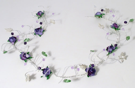 Wedding or prom hair vine with clusters of purple, tanzanite Swarovski crystals plus lilac roses