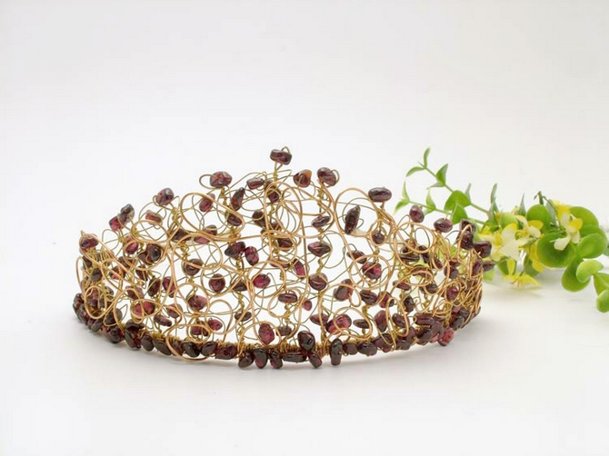 Gold and copper medieval wedding bride's tiara with semi-precious garnet stones.